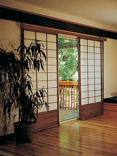 Shoji Doors. Translucent screen made of rice paper and wood frame. Used as a sliding door or partition in a Japanese house. Cherry Tree Design Patio Door Coverings.