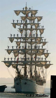 """Photographer's Note - """"Some years ago the Mexican sail training ship 'Cuauhtemoc' visited Auckland. i was driving past the wharf when I noticed the ship was leaving with sailors standing on the rigging in a gesture of farewell. I had left my camera at home - I was still using a film camera then & I think I was out of film, but I had my wife's new digital with me. I took quite a number of shots of this ship leaving Auckland on a cool but clear Winter's day."""""""