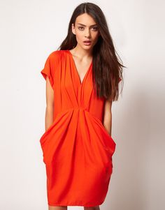 form flattering trash can dress. could maybe make this out of recycled prison jumpsuits.