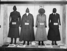 Four Red Cross uniforms, left to right: Motor Corps driver's skirt and tunic; Motor Corps driver's uniform; Motor Corps driver's overcoat; Foreign Service uniform