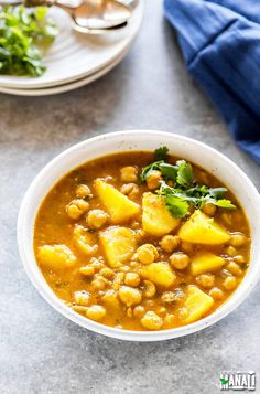 Potato & Chickpea Curry made in the Instant Pot! Vegan & gluten-free. Find the recipe on www.cookwithmanali.com