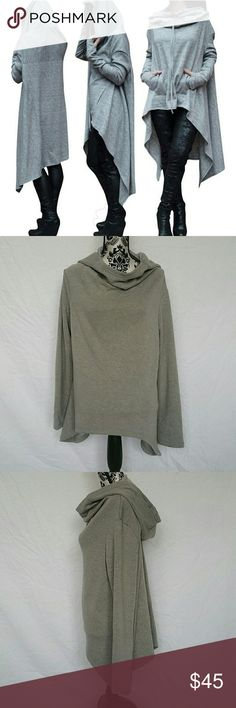 Grey Asymmetrical Hoody Sweater @tea_n_yoga at Poshmark   Grey Asymmetrical Sweater   ALSO AVAILABLE IN BLACK!  Has an edgy and yet comfy feel with a soft Plush interior.   True to size   100% Cotton   Note - Stock photo used to show similar style, not the actual item. No pockets. No string tie.  Showing size Large here. Sweaters Cowl & Turtlenecks