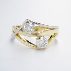 A 2 stone rub-over set round brilliant cut diamond wave & wishbone style ring mounted in 18ct. yellow gold and platinum. Dress Rings, Gold Platinum, Diamond Cuts, Waves, Engagement Rings, Stone, Yellow, Jewelry, Enagement Rings