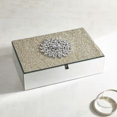 Our handcrafted, mirrored box, decorated with a beaded brooch, adds glitz to your dressing table or dresser. Use it for jewelry, notions or other treasures.