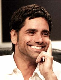 """John Stamos. In real life he is very close to Mary-Kate Olsen and Ashley Olsen, who played his niece Michelle on """"Full House"""" (1987)."""