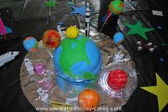 Homemade Solar System Cake: My son wanted a solar system cake for his 7th birthday party.  He really wanted the main cake to be Earth and the other planets orbiting around it. I am