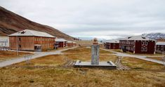 Pyramiden, Norway. The statue of Vladimir Lenin, another figure whose ideas have also been abandoned, is the visual focal point of the city. It is only accessible by boat or snowmobile.