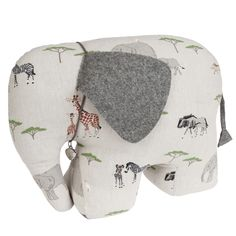 Elephant Door Stop   Sophie Allport   Our selection of door stops are the perfect gift to make any house a home. This cute elephant will stop your doors banging in style! It's both decorative and practical and will liven up any room. Especially good for a playroom or child's bedroom. Made from our Safari fabric it features elephants, giraffes, rhinos, zebras, warthogs and wilderbeast on a dusty white background.