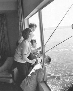 The Beatles fishing from a window in suite 272 at the Edgewater Hotel in Seattle WA, in August 1964.