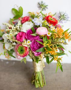 love this summer bouquet of ranunculus, mini daisies, anemones and roses by Bash, Please