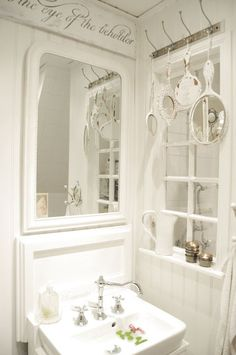 All white bath ~ Love the hanging mirrors