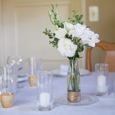 Simple DIY wedding centerpiece white roses and lisianthus and boxwood