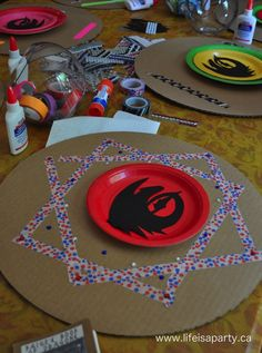 How To Train Your Dragon Birthday Party: Make your own shield, train your dragon stations, sensory table, and dragon training survival loot bags! Dragon Birthday Parties, Leo Birthday, Dragon Party, Toothless Toy, Toothless Party, Dragon Shield, Viking Shield, Viking Party, How To Train Dragon