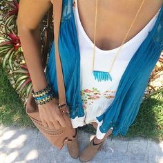 spring look: floral romper, tribal necklace, statement cuff, brown bag and fringe booties