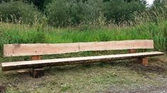 Fourteen feet ten inches of awesomeness on vashon island wa.  Live edge park bench Designed by John Mabry.