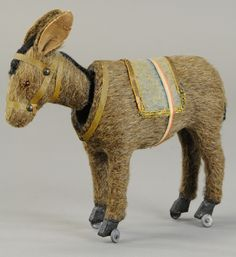 NODDING DONKEY ON WHEELS for auction. This whimsical donkey is covered with fur, glass eyes, long ears and black strip of fur down his neck, complete with harness and cloth saddle, stands on four metal wheels. Antique Toys, Vintage Toys, Rocking Horse Toy, Pull Along Toys, Old Toys, Children's Toys, Curiosity Shop, Toy Boxes, Kids Playing