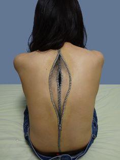 Zipper back. S)