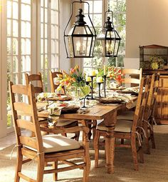 Grouped lanterns above a dining room table add a contemporary