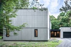 Brooklyn studio AlexAllen has revamped a home in New York State, trading its plywood siding for cement panels and blackened timber Exterior Wall Cladding, Timber Cladding, Fibre Cement Cladding, Plywood Siding, Cement Siding, New York Homes, American Houses, Facade Architecture, Residential Architecture