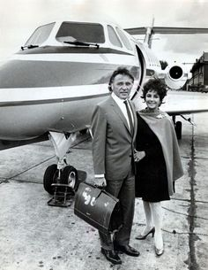 Elizabeth & her 5th & 6th husband Richard Burton in front of their jet after arriving at RAF Abingdon. The jet was a birthday present for Elizabeth  from Richard