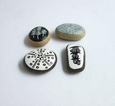 set of 4 painted pebbles.    I collected those pebbles on a beach of the mediterranean coast in south of France.    I took my inspiration in the discreet
