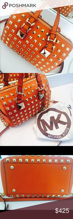 Micheal Kors Grayson Studded Bag Beautiful bag!!! The bag has never been worn!! Was given as gift!! The color is tangerine and it's very sturdy. Very EXCLUSIVE!!! Not many left!! Bag comes with the strap! Bags Totes