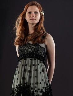 I do love the dress that Ginny wore in the film for Bill & Fleur's wedding, but part of me was still a little annoyed that it wasn't a simple gold dress as described in the book.