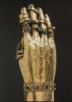 Arm Reliquary of Saint Blaise, 1400, Braunschweig, Germany, wood and silver-gilt. The rings are offerings from that date to ca. 1600 in approximate order on each finger.