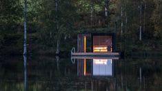 Small Architecture Workshop's charred-wood sauna floats on Swedish lake