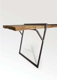 quadra, a minimalist table created by italy-based designer luis arrivillaga ... the loop stand frame in powdercoated steel was designed as a universal table that allows for infinite lengths . via http://leibal.com/furniture/quadra/