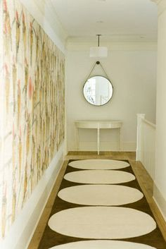 Narrow hallway problem.  Wide round pattern hall runner, large scale round wall hanging at end of hall.