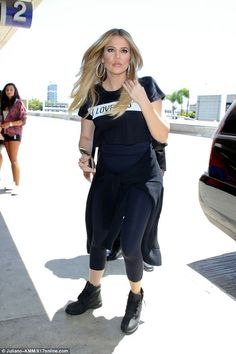 Dash my clothing brand dash by nature! Khloe Kardashian was dressed to sprint through LAX on Wednesday when she arrived at the airport