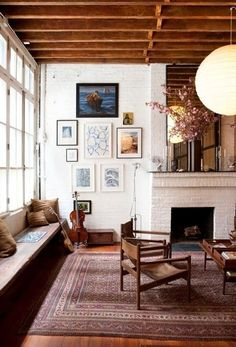wood beams, white brick fireplace, paper lantern