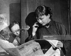 Chinese-American actress Anna May Wong (1907 - 1961), the stage name of Wong Liu Tsong, reads an article in the newspaper in a scene from 'Piccadilly', directed by Ewald Andre Dupont for British International Pictures.