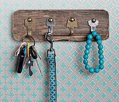 Cute little board by Rosely Pignataro.  This site has many ideas for various types of hooks and storage.