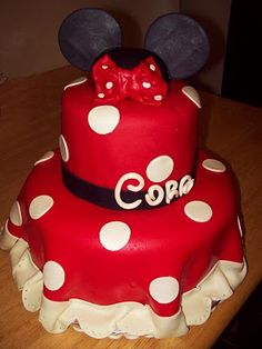 How cute is this Minnie Mouse Cake?  I love the eyelit lace and that the fondant looks like a dress