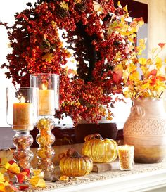 Hanging a fall wreath on a mirror doubles its berry capacity