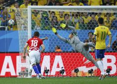 Brazil v Croatia: Group A - 2014 FIFA World Cup Brazil - Brazil's Julio Cesar (C) jumps as he tries to save a ball during their 2014 World Cup opening match against Croatia at the Corinthians arena in Sao Paulo June 12, 2014. (REUTERS/Kai Pfaffenbach)
