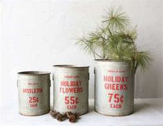 """Holly Jolly - Holiday Market Style Buckets are irresistible! The red print and rustic finish on these three are pure perfection. A holiday must have for your farmhouse holiday look!13-3/4"""" Round x 17""""H, 15-3/4"""" Round x 20""""H,"""