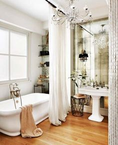 love the antiqued mirrors behind sink