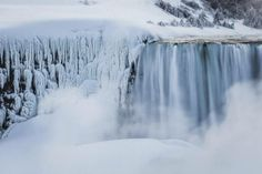 A partially frozen American Falls is seen during sub freezing temperatures in Niagara Falls, Ontario, March 3, 2014. (Mark Blinch/Reuters)