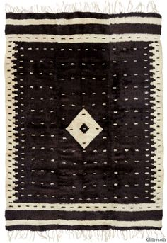 Beautiful vintage Siirt blanket handwoven by Yoruk tribes with undyed mohair. Siirt is located in Eastern Turkey and is famous with these blankets also used as rugs, bedspreads and throws. This piece is around 70 years old and in very good condition.