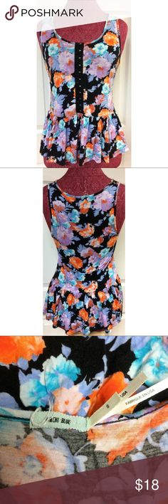 Kimchi Blue Neon Floral Tank Top Blouse Size Small For sale we have a Kimchi Blue Urban Outfitters black and neon floral snap front top size small. It has a small spot that should wash out and a little wear under one snap. Please view all pictures.  Approximate measurements: Chest: 29 inches around Length shoulder to hem: 24.5 inches Kimchi Blue Tops Blouses