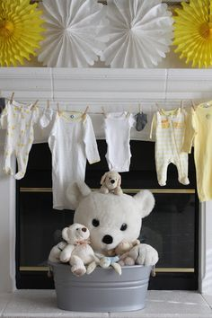 Gender Reveal baby shower ~ Grey and Yellow  Maybe use all white baby clothes then either solid pink or blue outfit in the middle or in third place to reveal gender