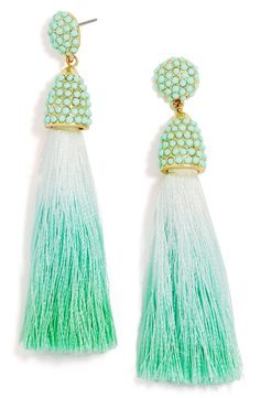 Pristine white tassels are dipped in soft, springy hues, for an ombré effect to these crystal-encrusted drop earrings.