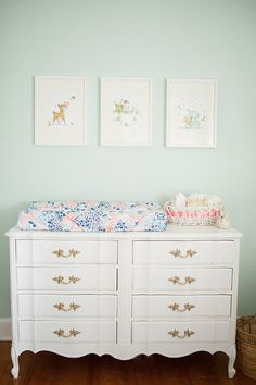 Pastel color on walls, white furniture, vintage art and tiny floral print on linens.