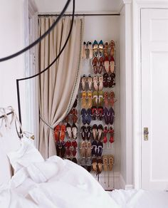 Original zapatero oculto tras la cortina, en un pequeño espacio del dormitorio.  5 Genius Hidden Storage Solutions for Small Spaces :: via www.artsandclassy.com