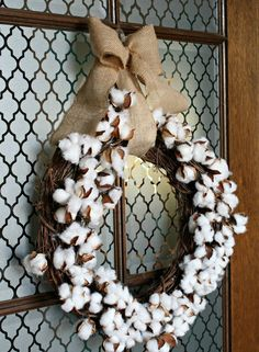 top your cotton ball wreath with a burlap bow to hang it