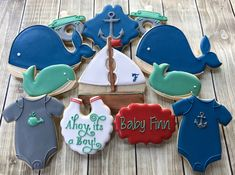1 Dozen Nautical Baby Shower Cookies, Whales, Sailboats, Anchor, Onesies by FlourishCookies on Etsy https://www.etsy.com/listing/535985080/1-dozen-nautical-baby-shower-cookies