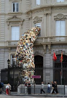Spanish artist Alicia Martin takes book art to a new level. Here, they explode out of a building window like a waterfall. More examples at the link....